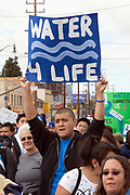 March for Water, World Water Day 2009, in downtown Los Angeles. March 22, 2009. A community march highlighting the local state water crisis that has resulted from a dysfunctional management, and to raise awareness of the plight of the people that are suffering from a global mismanagement of water. Starting at Los Angeles Historic Park, the length of the march is approximately 3 miles, the distance that on average people in other places of the world have to walk to find water to sustain their lives, many marchers will be carrying water vessels on their heads throughout the march in an act of solidarity with others around the world.  Community-Based Organizations & Environmental Justice Groups  will be marching as well as students of all ages (including 3 elementary schools) from all over the city will have banners representing their schools and their love for water.