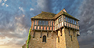 """The half timbered north tower built in the 1280s, the  finest fortified medieval manor house in England, Stokesay Castle, Shropshire, England . Stokesay Castle is one of the finest surviving fortified manor houses in England, and situated at Stokesay in Shropshire. It was largely built in its present form in the late 13th century by Laurence de Ludlow, on the earlier castle. Architecturally, Stokesay Castle is """"one of the best-preserved medieval fortified manor houses in England"""", according to historian Henry Summerson.[1] The castle comprises a walled, moated enclosure, with an entrance way through a 17th-century timber and plaster gatehouse. Inside, the courtyard faces a stone hall and solar block, protected by two stone towers. The hall features a 13th-century wooden-beamed ceiling, and 17th-century carved figures ornament the gatehouse and the solar. <br /> <br /> Visit our MEDIEVAL PHOTO COLLECTIONS for more   photos  to download or buy as prints https://funkystock.photoshelter.com/gallery-collection/Medieval-Middle-Ages-Historic-Places-Arcaeological-Sites-Pictures-Images-of/C0000B5ZA54_WD0s"""