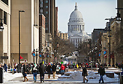 """MADISON, WI — FEBRUARY 13, 2015: Crowds begin to gather before the """"Stop the Cuts"""" Rally on Library Mall, Saturday, February 14, 2015. The rally drew hundreds of student, faculty and community supporters in spite of the cold Midwest weather."""