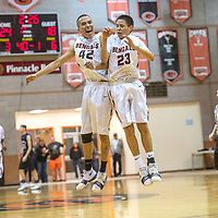 Gallup Bengals Asa Holyan (42), left, and Tyrell Begay (23) after Begay posted a there-point basket on the Miyamura Patriots in the district 1-5A tournament game at Gallup High School Wednesday. The Bengals outlasted the Patriots with a 41-38 win.