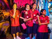 20 NOVEMBER 2015 - BANGKOK, THAILAND:  High school students line up to go into a haunted house at the Wat Saket temple fair. Wat Saket is on a man-made hill in the historic section of Bangkok. The temple has golden spire that is 260 feet high which was the highest point in Bangkok for more than 100 years. The temple construction began in the 1800s in the reign of King Rama III and was completed in the reign of King Rama IV. The annual temple fair is held on the 12th lunar month, for nine days around the November full moon. During the fair a red cloth (reminiscent of a monk's robe) is placed around the Golden Mount while the temple grounds hosts Thai traditional theatre, food stalls and traditional shows.    PHOTO BY JACK KURTZ