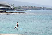 """Woman and dog on a Hawaiian """"stand up paddle"""" board, Kailua Bay, Kailua-Kona, Big Island, Hawaii"""