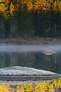 New Hampshire lake and morning mist in autumn