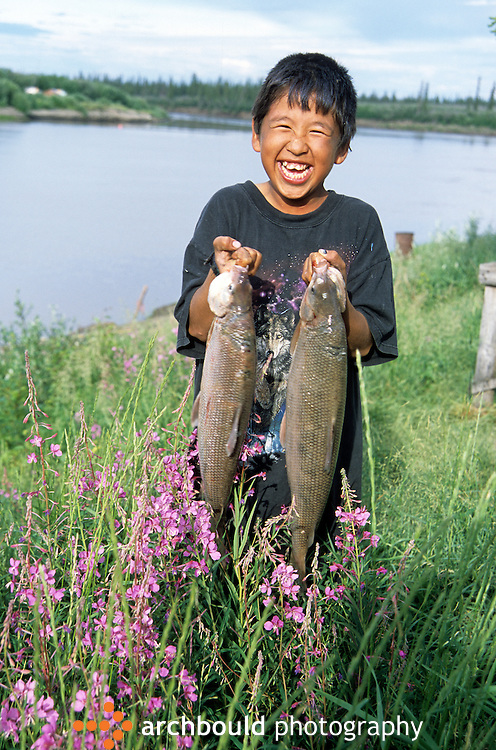 Smiling boy shows off the fish that he just caught<br /> <br /> NOT IN YOUR BUDGET? Contact Cathie for a price specific to your project.