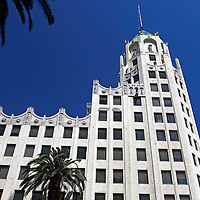 USA, California, Los Angeles. First National Bank of Hollywood building and trees.