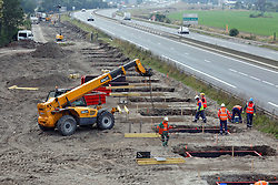 Workers dig foundations of a wall near Calais migrant Jungle camp along the road leading to the harbour of Calais, northern France on September 22, 2016 to stop migrants from jumping on lorries heading to Britain. Up to 10,000 migrants are now living at the camp and are using desperate and violent measures to try and board trucks heading for the UK. Photo by Sylvain Lefevre/ABACAPRESS.COM
