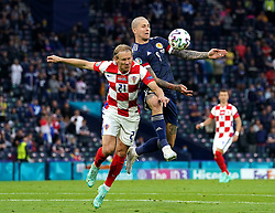 Croatia's Domagoj Vida (left) and Scotland's Lyndon Dykes battle for the ball during the UEFA Euro 2020 Group D match at Hampden Park, Glasgow. Picture date: Tuesday June 22, 2021.