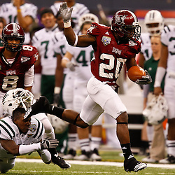 December 18, 2010; New Orleans, LA, USA; Troy Trojans running back Shawn Southward (20) knocks the helmet of Ohio Bobcats cornerback Julian Posey (9) as he escapes a tackle during the first half of the 2010 New Orleans Bowl at the Louisiana Superdome.  Mandatory Credit: Derick E. Hingle