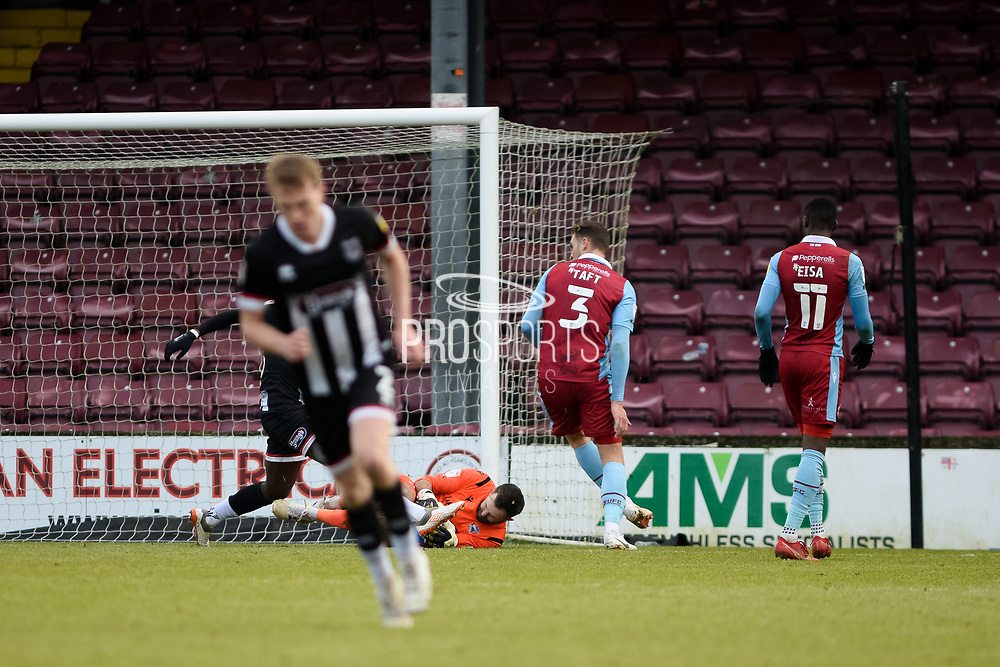 Scunthorpe United Mark Howard (33) makes a save during the EFL Sky Bet League 2 match between Scunthorpe United and Grimsby Town FC at the Sands Venue Stadium, Scunthorpe, England on 23 January 2021.