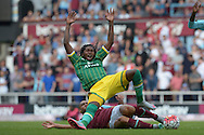 Winston Reid of West Ham United fouls Dieumerci Mbokani of Norwich City. Barclays Premier League, West Ham Utd v Norwich city at The Boleyn Ground, Upton Park in London on Saturday 26th September 2015.<br /> pic by John Patrick Fletcher, Andrew Orchard sports photography.