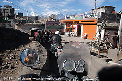 Riding back to Muktinath from the Buddhist temple above the town on day-6 of our Himalayan Heroes adventure riding from Muktinath to Tatopani, Nepal. Sunday, November 11, 2018. Photography ©2018 Michael Lichter.