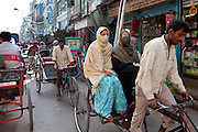 Muslim women in rickshaw in Old Delhi, India