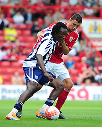 Bristol City's James Wilson battles for the ball with West Bromwich Albion's Somen Tchoyi  - Photo mandatory by-line: Joseph Meredith / JMPUK - 30/07/2011 - SPORT - FOOTBALL - Championship - Bristol City v West Bromwich Albion - Ashton Gate Stadium, Bristol, England