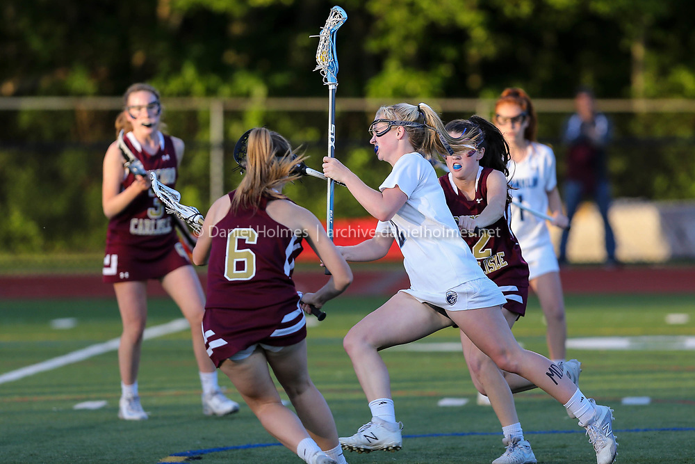 (6/9/17, MILFORD, MA) Franklin's Kelsey MacCallum drives to the net and scores during the Division 1 East girls lacrosse championship game against Concord-Carlisle at Milford High School on Friday. [Daily News and Wicked Local Photo/Dan Holmes]