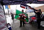 Randal Thom, a supporter of U.S. President Donald Trump, prepares a flag outside a site for Trump's rally taking place the next day, in Des Moines, Iowa, U.S., January 29, 2020. REUTERS/Rick Wilking