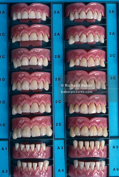 Acrylic teeth samples displayed at Ivoclar in Schaan, Liechtenstein who export 60 million false dentures a year worldwide