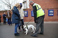 Security with sniffer dogs checking bags outside Stamford Bridge before k/o. Premier league match, Chelsea v Stoke city at Stamford Bridge in London on Saturday 31st December 2016.<br /> pic by John Patrick Fletcher, Andrew Orchard sports photography.