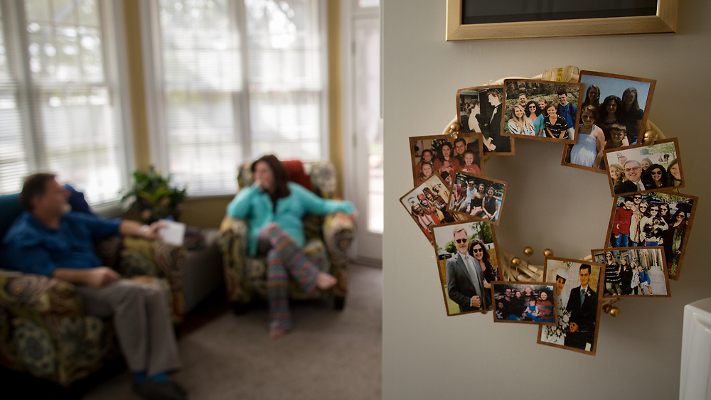 BLACKSHEAR, GA - MARCH 25, 2021: Lisa Martin's family is celebrated with a collage of photos near where she and her husband Jeff spend most of their time together. In December of 2020 was released from the hospital after a long battle with battling COVID-19. (AJC Photo/Stephen B. Morton)