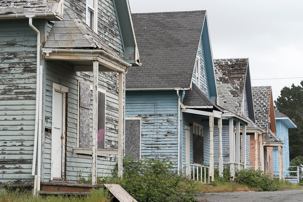 Row of boarded up houses in the company town of Samoa, California.