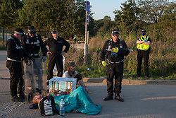 A Hertfordshire Police cutting team prepares to remove two environmental activists from HS2 Rebellion locked together in the road using a lock-on arm tube to block a gate to a site for the Chiltern Tunnel on the route of the HS2 high-speed rail link on 14 September 2020 in West Hyde, United Kingdom. Anti-HS2 activists blocked two gates to the same South Portal site for the controversial £106bn rail line, one for over six hours and the other for over nineteen hours.