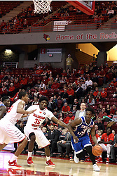 22 December 2015: Xavier Richards(3) cuts the corner and hustles trying to get past Roland Griffin(35) and Deontae Hawkins(23). Illinois State Redbirds host the Tennessee State Tigers at Redbird Arena in Normal Illinois (Photo by Alan Look)