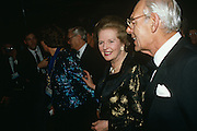 Prime Minister Margaret Thatcher arrives with her late-husband Dennis at the formal 1990 Tory Party conference ball.