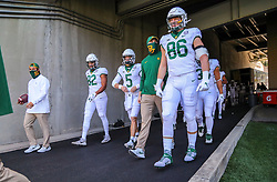 Oct 3, 2020; Morgantown, West Virginia, USA; Baylor Bears quarterback Charlie Brewer (5) walks onto the field with teammates tight end Tyler Henderson (82) and tight end Ben Sims (86) prior to their game against the West Virginia Mountaineers at Mountaineer Field at Milan Puskar Stadium. Mandatory Credit: Ben Queen-USA TODAY Sports