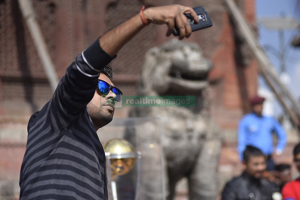 October 29, 2018 - Kathmandu, NP, Nepal - A Nepalese youth takes selfie along with the 2019 ICC Cricket World Cup trophy in Basantapur Durbar Square during a country tour in Kathmandu, Nepal on Monday, October 29, 2018. The 2019 Cricket World Cup is to be hosted by England and Wales from 30 May to 14 July 2019. (Credit Image: © Narayan Maharjan/NurPhoto via ZUMA Press)