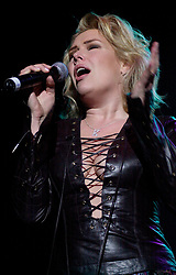 Kim Wilde steps out of the her TV Gardening clothes and Back on Stage to Tour with<br /><br />Steve Starnge (Visage)<br />Claire Grogan (Altered Images)<br />The Belle Stars<br />Dollar<br />Kim Wilde<br />The Human League<br />Play on the Here and Now  Christmas Party Tour at Sheffields Hallam FM Arena Friday 13th December 2002<br /><br />[#Beginning of Shooting Data Section]<br />Nikon D1 <br />2002/12/13 22:24:45.6<br />JPEG (8-bit) Fine<br />Image Size:  2000 x 1312<br />Color<br />Lens: 80-200mm f/2.8-2.8<br />Focal Length: 80mm<br />Exposure Mode: Manual<br />Metering Mode: Spot<br />1/200 sec - f/2.8<br />Exposure Comp.: 0 EV<br />Sensitivity: ISO 800<br />White Balance: Auto<br />AF Mode: AF-S<br />Tone Comp: Normal<br />Flash Sync Mode: Not Attached<br />Color Mode: <br />Hue Adjustment: <br />Sharpening: Normal<br />Noise Reduction: <br />Image Comment: <br />[#End of Shooting Data Section]