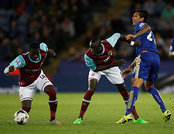 Pedro Obiang (L) and Cheikhou Kouyate of West Ham United in action against Leonardo Ulloa of Leicester City (R)  - Mandatory byline: Jack Phillips/JMP - 07966386802 - 22/09/2015 - SPORT - FOOTBALL - Leicester - King Power Stadium - Leicester City v West Ham United - Capital One Cup Round 3