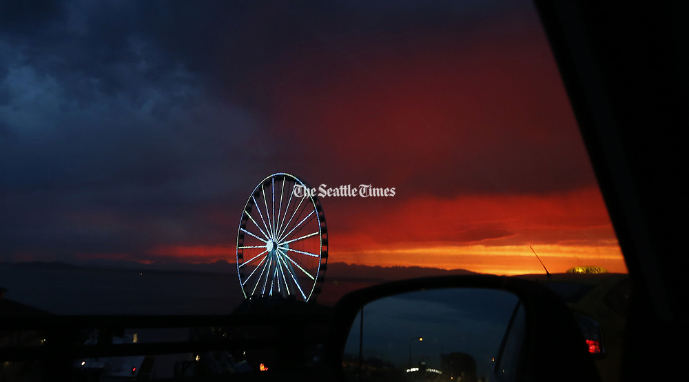 Sunset over Elliott Bay from the Alaskan Way Viaduct with the waterfront's Great Wheel. (Alan Berner / The Seattle Times)