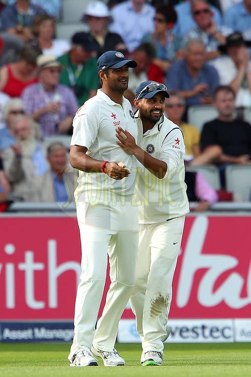 Pankaj Singh of India and Murali Vijay of India celebrate the wicket of Alastair Cook captain of England during day one of the fourth Investec Test Match between England and India held at The Emirates, Old Trafford cricket ground in Manchester, England on the 7th August 2014<br /> <br /> Photo by Ron Gaunt / SPORTZPICS/ BCCI