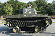 A golf cart decorated as a military tank takes part in the  annual Independence Day parade July 4, 2019 in Sullivan's Island, South Carolina. The tank was a tongue-in-check reference to the controversy over the military parade in Washington.