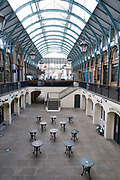 With very few people out and about the scene inside Covent Garden Market is one of desolation with all tables and chairs empty as the national coronavirus lockdown three continues on 29th January 2021 in London, United Kingdom. Following the surge in cases over the Winter including a new UK variant of Covid-19, this nationwide lockdown advises all citizens to follow the message to stay at home, protect the NHS and save lives.