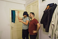 Omar (left) throws a dart at home with his partner Nader. The two Syrians lived together in Turkey for almost a year, until tomorrow when Nader departs for Bergen, Norway, where he has been granted political asylum.