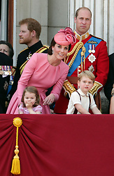 Duchess of Cambridge with Princess Charlotte and Prince George as The Duke of Cambridge and Prince Harry looks on, on the balcony of Buckingham Palace, in central London, following the Trooping the Colour ceremony at Horse Guards Parade as the Queen celebrates her official birthday today.