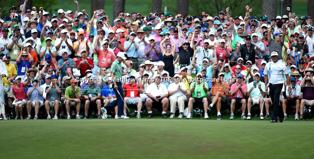 Bubba WATSON (USA) birdies the 6th par 3 during fourth round US Masters 2014,Augusta National,Augusta, Georgia,USA.