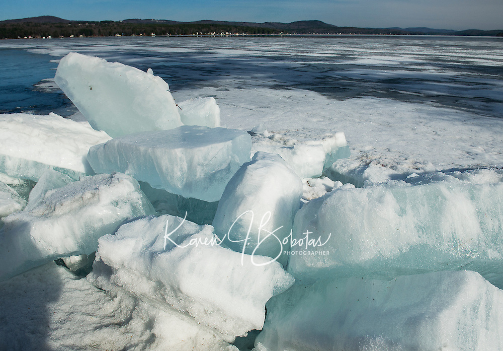 Leslie E. Roberts Beach in Belmont is in need of  warmer Spring cleanup as large ice chunks washed up on shore from strong winds on Lake Winnisquam this week.  (Karen Bobotas/for the Laconia Daily Sun)