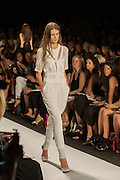 A white pants suit with lace accents at the BCBGMAXAZRIA show at the Spring 2013 Mercedes Benz Fashion Week show in New York.
