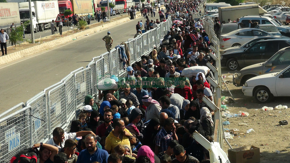 June 16, 2017 - Kilis, Turkey - Thousands of refugees walked back home into Syria from Turkey ahead of the Eid festival that marks the end of the Muslim holy month of Ramadan. Turkey has taken in some 3 million Syrian migrants since the start of civil war in 2011, making it home to the world's largest refugee population. Now Ankara is giving Syrian refugees the right to return to Turkey within a month if they want to go home to celebrate the Eid al-Fitr holiday.  (Credit Image: © Dha/Depo Photos via ZUMA Wire)