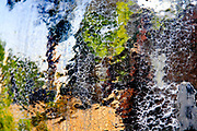 defocused outdoors Abstract photographed through wet glass