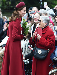 The Duchess of Cambridge speaks with Jill Lee, 71, from Cambridge as she arrives to attend the Christmas Day morning church service at St Mary Magdalene Church in Sandringham, Norfolk.