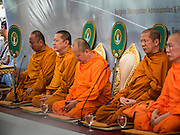21 AUGUST 2015 - BANGKOK, THAILAND:      Thai Buddhist monks at a merit making ceremony at Central World to honor the dead from the Erawan Shrine bombing. The Bangkok Metropolitan Administration (BMA) held a religious ceremony Friday for the Ratchaprasong bomb victims. The ceremony started with a Brahmin blessing at Erawan Shrine, which was the target of a bombing Monday night. After the blessing people went across the street to the plaza in front of Central World mall for an interfaith religious service. Theravada Buddhists, Mahayana Buddhists, Muslims, Sikhs, Hindus, and Christians participated in the service. Life at the shrine, one of the busiest in Bangkok, is returning to normal. Friday the dancers and musicians who perform at the shrine resumed their schedules.     PHOTO BY JACK KURTZ