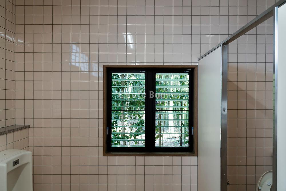 window view of garden seen from a male public toilet room Japan Kyoto
