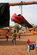 In the AMPO orphanage yard the football kit hangs out to dry ready for the Coaching for Hope tournament in Burkina Faso. All the children's football kit is cleaned after every use. Coaching for Hope is a project to raise awareness of HIV and AIDS through football.