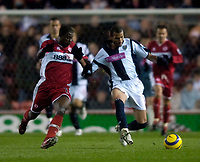 Photo: Jed Wee.<br /> Middlesbrough v West Bromwich Albion. The Barclays Premiership. 27/11/2005.<br /> <br /> West Brom's Diomansy Kamara (R) tries to get away from Middlesbrough's George Boateng.