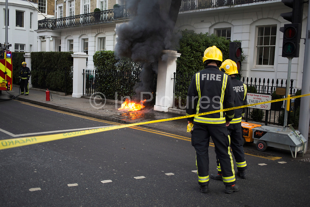 London Fire Brigade firefighters attend an electrical blaze in West London, England, United Kingdom.