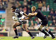 Twickenham, Surrey, 4th December 2004, The Gartmore Challenge Rugby Cup,  Barbarians vs New Zealand, RFU Stadium, England,<br /> [L] Australian Lotu Tuqiri is tracked by Mose Tuiali'i<br /> <br /> [Mandatory Credit; Peter Spurrier/Intersport Images]
