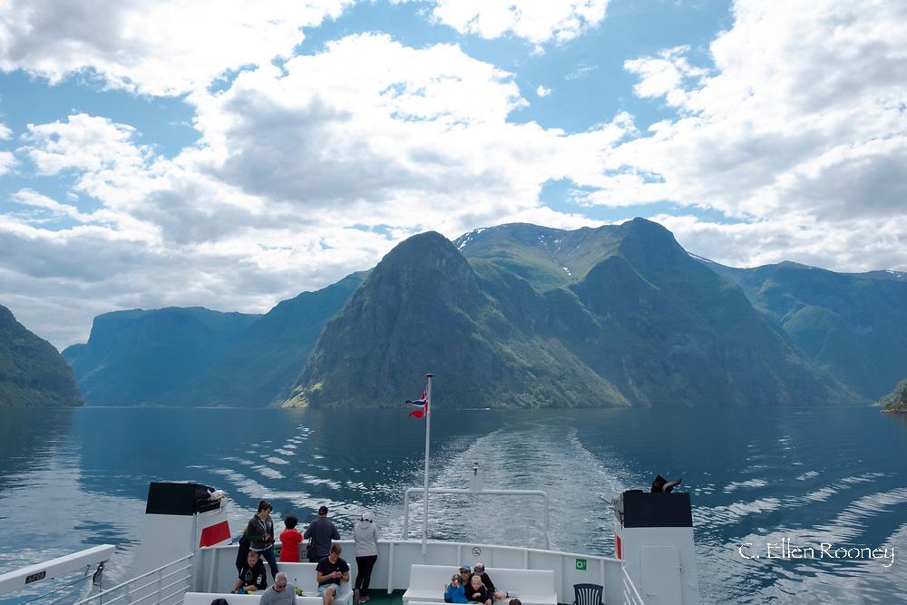 A sightseeing boat cruising on Naeroy Fjord, Vestlandet, Norway