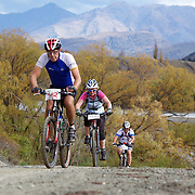 Angus Bradshaw (left), Victoria Robertson (centre) and Shane Muir (right) in action during the New World Tour de Wakatipu bike race on Saturday. Six hundred and ninety people entered the bike race which featured an  exclusive course with breathtaking views from Millbrook Resort in Arrowtown to Chard Farm along the Kawarau River, via the trails and tracks of the Wakatipu basin with distances of 36 kilometres fun riding for recreational bikers and 45 kilometres for elite and sport racers. The event was part of the inaugural Queenstown Bike Festival, which took place from 16th-25th April. The event hopes to highlight Queenstown's growing profile as one of the three leading biking centres in the world. Queenstown, Central Otago, New Zealand. 23rd April 2011. Photo Tim Clayton..